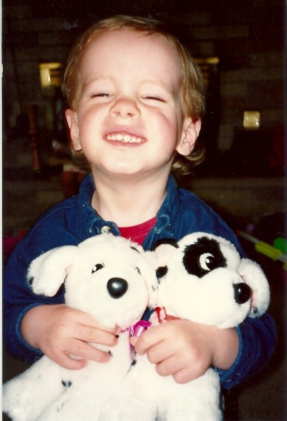 Harry dancing with stuffed toy dalmatian pups, 1992